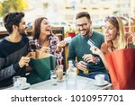 group of four friends having... | Shutterstock . vector #1010957701