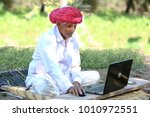 indian grandpa happy to use... | Shutterstock . vector #1010972551