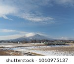 japan local train with mountain ... | Shutterstock . vector #1010975137