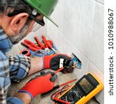 electrician technician with... | Shutterstock . vector #1010988067