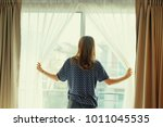 day off. good morning. a woman... | Shutterstock . vector #1011045535