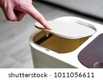 open the lid of the trash can | Shutterstock . vector #1011056611