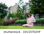 pregnant woman sitting and...   Shutterstock . vector #1011070249