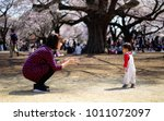 mother waiting for her child... | Shutterstock . vector #1011072097