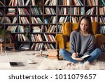 young woman writer in library... | Shutterstock . vector #1011079657