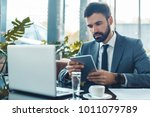 businessman sitting in a... | Shutterstock . vector #1011079789