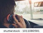 handsome man using smartphone... | Shutterstock . vector #1011080581