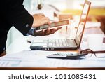 a businessman analyzing... | Shutterstock . vector #1011083431