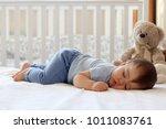 funny baby sleeping on his... | Shutterstock . vector #1011083761