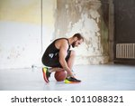 young man basketball player is... | Shutterstock . vector #1011088321