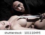 A fantasy scene of woman sacrifice in the dark - stock photo