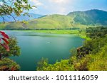 shore of the magnificent lake... | Shutterstock . vector #1011116059