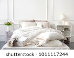 bedroom interior with linen... | Shutterstock . vector #1011117244