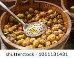 closeup of  spicy olives at the ... | Shutterstock . vector #1011131431