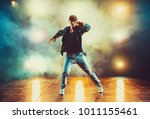 young man break dancing in club ... | Shutterstock . vector #1011155461