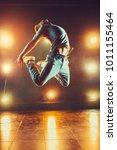 young man break dancing in club ...   Shutterstock . vector #1011155464