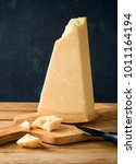parmesan cheese on wooden table ... | Shutterstock . vector #1011164194