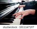 female hands playing piano | Shutterstock . vector #1011167197