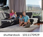 young happy family relaxing at... | Shutterstock . vector #1011170929