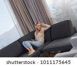 young beautiful girl enjoying... | Shutterstock . vector #1011175645