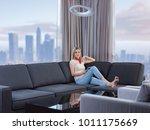 beautiful young woman on sofa... | Shutterstock . vector #1011175669