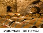 wine barrels and bottles in a... | Shutterstock . vector #1011195061