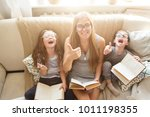 happy family reading books... | Shutterstock . vector #1011198355