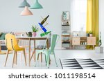 yellow and mint chairs standing ... | Shutterstock . vector #1011198514