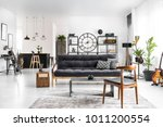 wooden chair next to table and...   Shutterstock . vector #1011200554