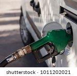 gasoline pump noose in fuel... | Shutterstock . vector #1011202021