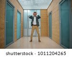 Small photo of Help me. Full length portrait of unnerved guy is standing in hallway and touching his head while expressing chagrin