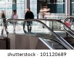 rail station with people in motion blur at the escalator - stock photo