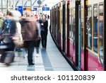 people at a railway station traveling by train - stock photo