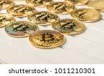 bitcoin replica over white...   Shutterstock . vector #1011210301