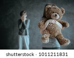 in the foreground kid holding a ... | Shutterstock . vector #1011211831