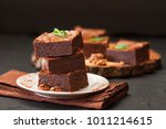chocolate brownie square pieces ... | Shutterstock . vector #1011214615