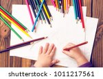 the child's hands are painted... | Shutterstock . vector #1011217561