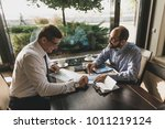 two business people at a... | Shutterstock . vector #1011219124