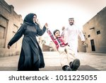 arabic family playing with child | Shutterstock . vector #1011225055