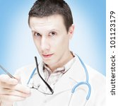 The serious doctor. It is isolated on a white background - stock photo