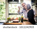 senior couple cooking healthy... | Shutterstock . vector #1011242905