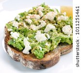 avocado toast with feta cheese... | Shutterstock . vector #1011251461