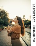 young woman enjoying the sunset | Shutterstock . vector #1011253519