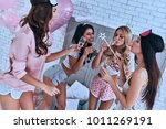 private party. four attractive... | Shutterstock . vector #1011269191
