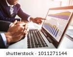 two businesspeople working... | Shutterstock . vector #1011271144