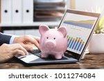 businessperson analyzing graph...   Shutterstock . vector #1011274084