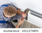 close up of male plumber fixing ... | Shutterstock . vector #1011274891