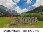 Small photo of Corvara, Italy - May 31, 2017: Entrance of the village Corvara in South Tyrol with a pink bicycle symbolizing cycling race Giro dâ??Italia went through at 18th stage