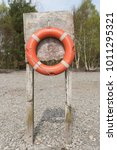 an old orange rustic life buoy... | Shutterstock . vector #1011295321