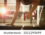 healthy young woman lifting... | Shutterstock . vector #1011295699